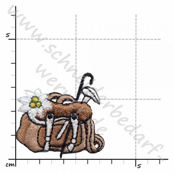 Applikation zum Aufbügeln (Rucksack mit Stock und Blume)